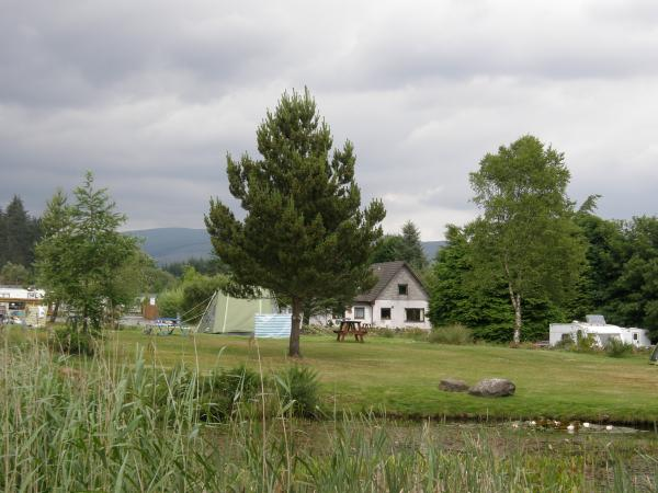 View of tent and tourer area from the far side of the pond